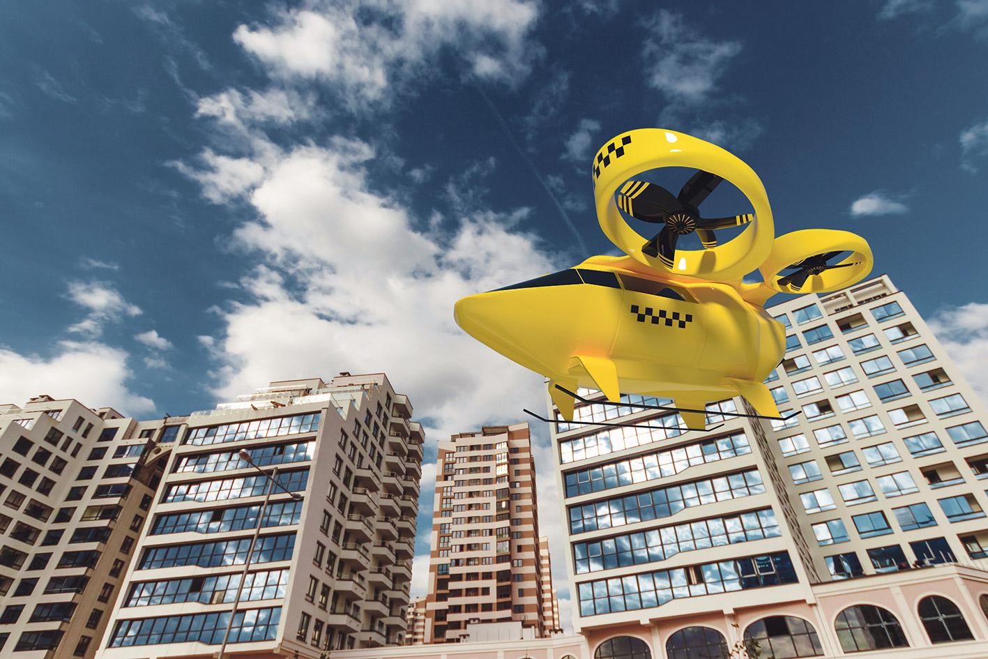 Zukunftsvision: Ein Flugtaxi vor Gebäuden